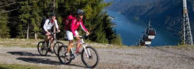 Mountain bikers on the mountain with a view of the Lake Achensee