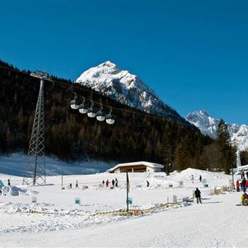 Ski area with mountain railway in winter