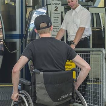 Wheelchair users get into the gondola