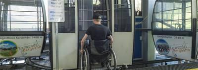 Wheelchair user gets into a gondola