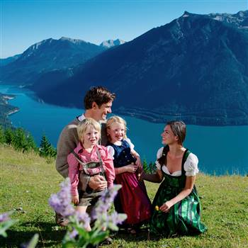 Family on the mountain with the lake in the background