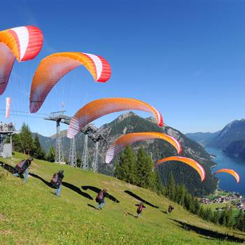 Several paragliders at the start