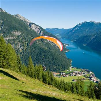 Paraglider flies down the mountain