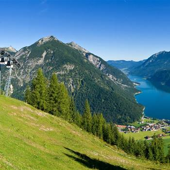 Paraglider flies over the Lake Achensee