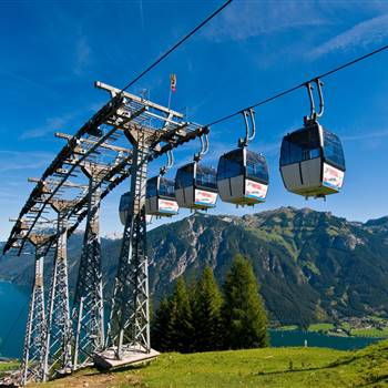 Gondolas of the mountain railway in summer