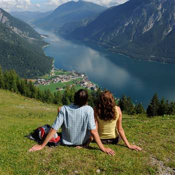 Couple is looking from the mountain on the Lake Achensee
